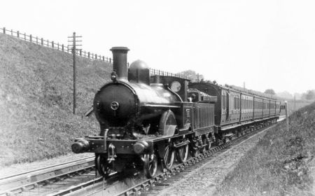 A Roberts 2-4-0 with a train of six-wheelers